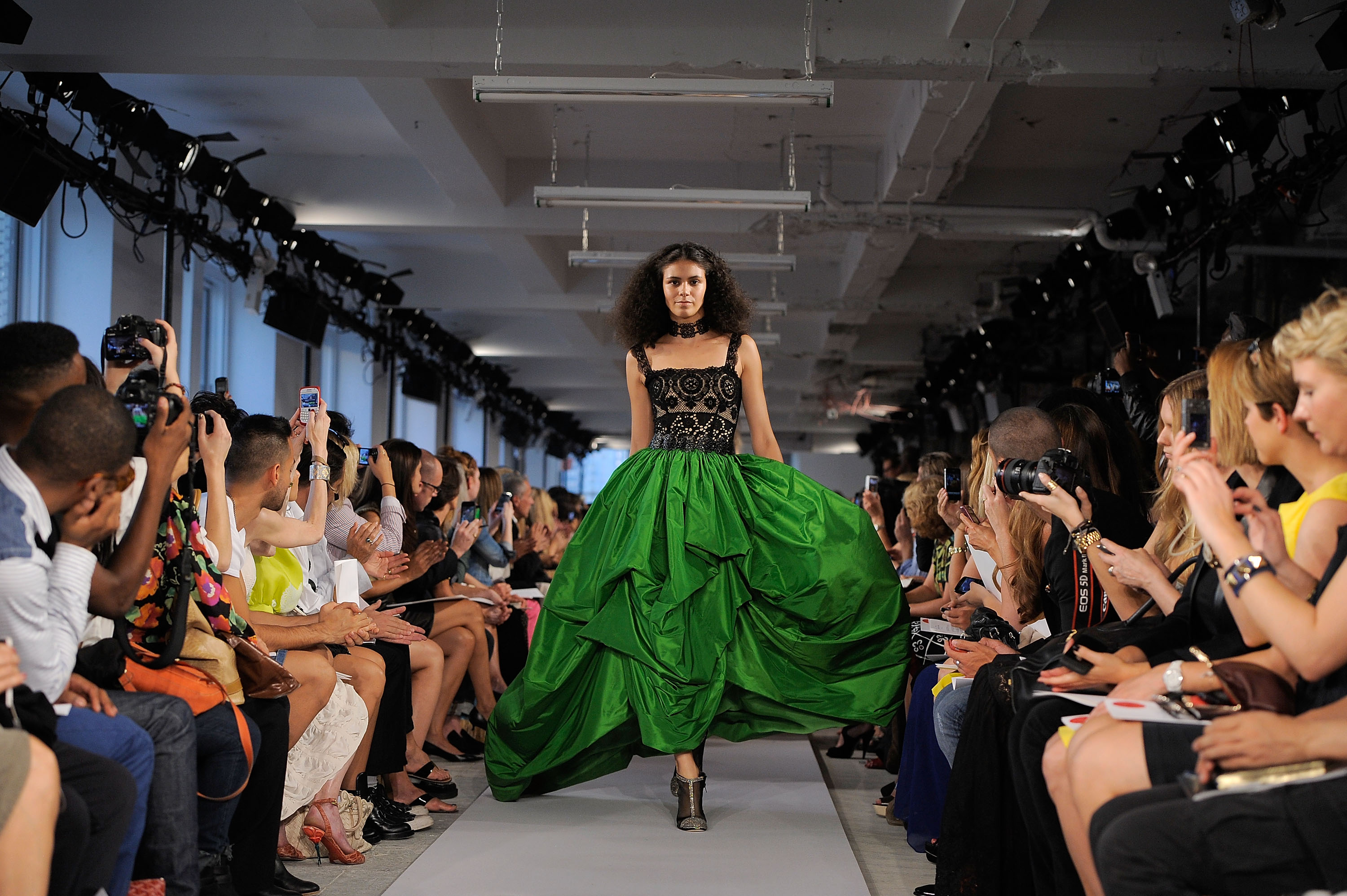 NEW YORK, NY - SEPTEMBER 13:  A model walks the runway at the Oscar De La Renta Spring 2012 fashion show during Mercedes-Benz Fashion Week on September 13, 2011 in New York City.  (Photo by Jemal Countess/Getty Images)
