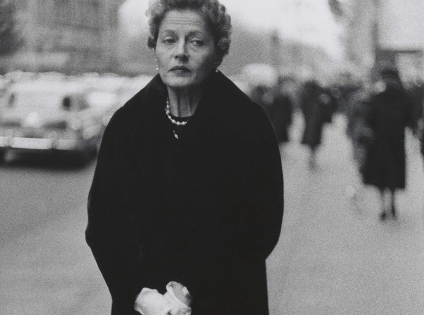 Diane Arbus. Woman with white gloves and a pocket book, N.Y.C. 1956.