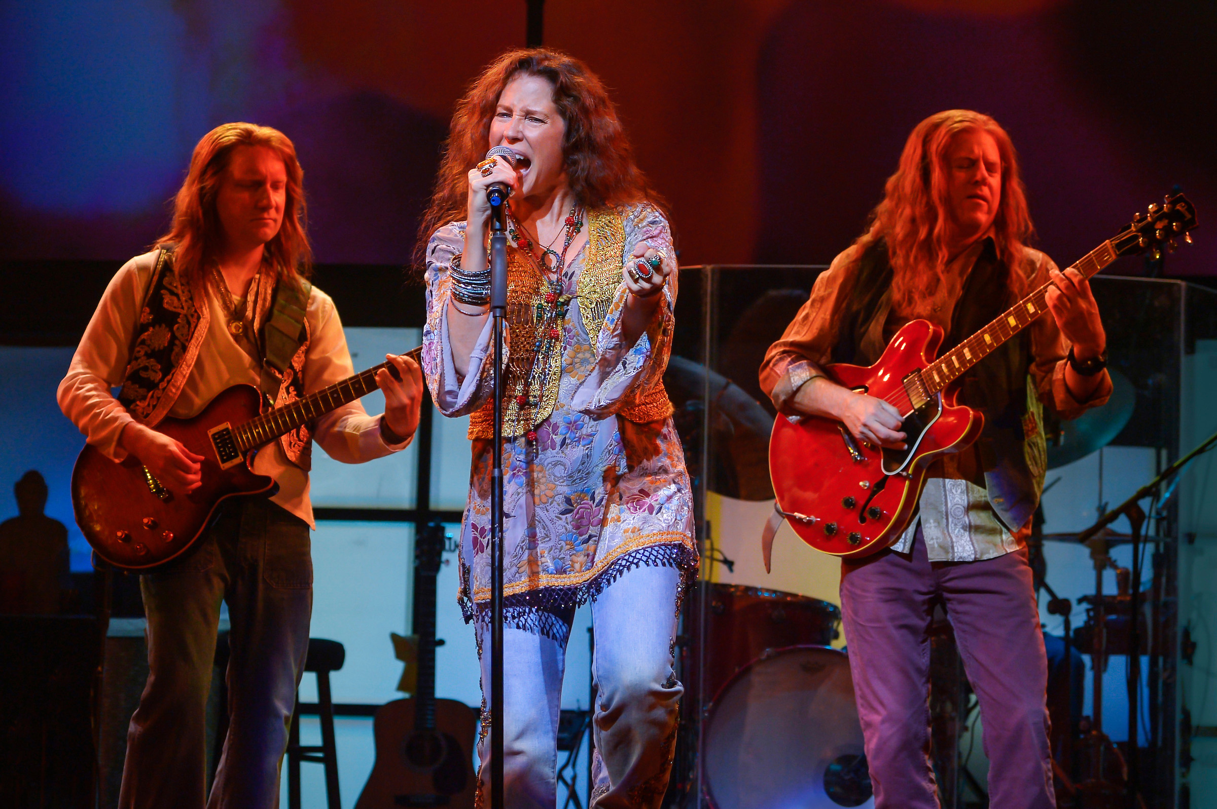 Kacee Clanton as the iconic Janis Joplin. Background (L-R): Mike Smith and Michael Lent. Photo: Kevin Berne.