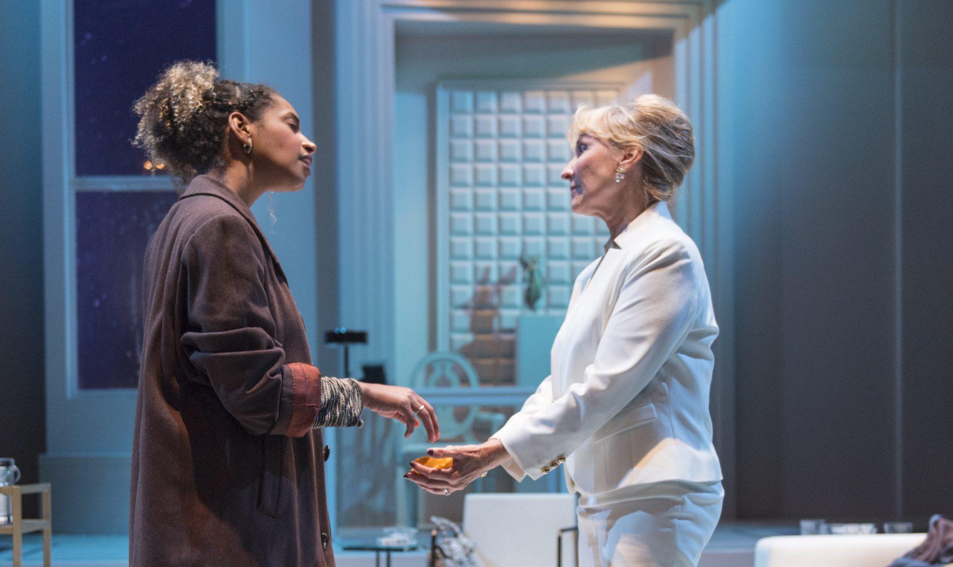 , Glima (Sam Jackson) dumps her orange peels into Micheleine's (Lorri Holt*) hands. Photo by David Allen.