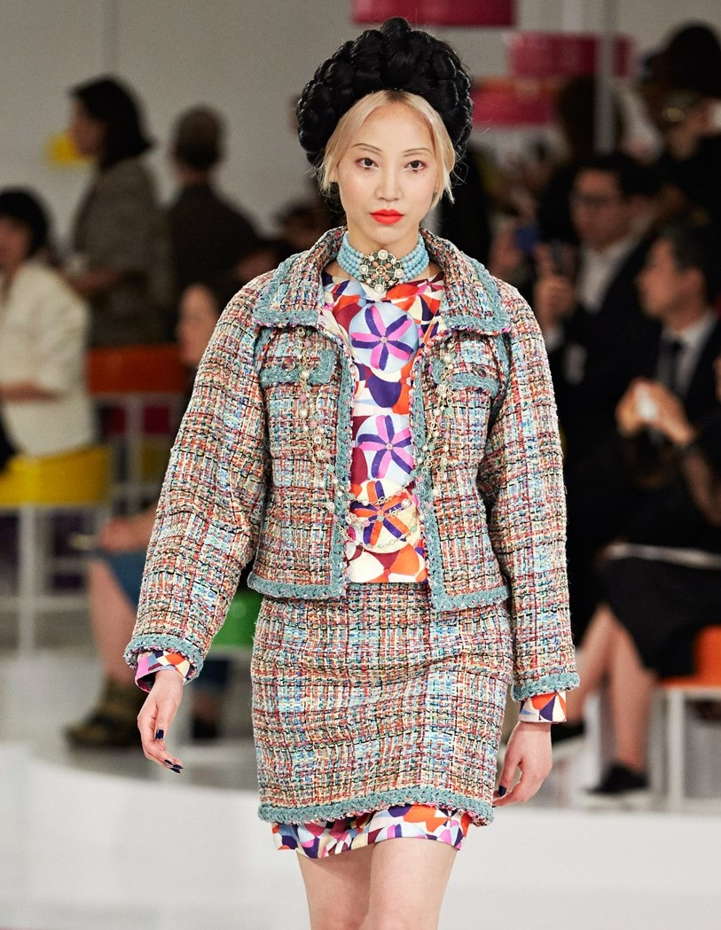 Ensemble inspired by traditional Korean wrapping cloth (bojagi), from the Cruise collection, 2016, by Karl Lagerfeld (German, b. 1938) for Chanel. Jacket and skirt: wool tweed; blouse: silk twill; pumps: calfskin; jewelry: pearl and glass. Chanel Patrimoine Collection, Paris. Photograph © Chanel